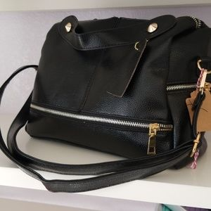 Handbags - Black purse with gold detailing.